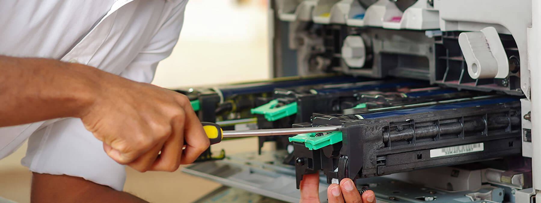Man Fixing Printer