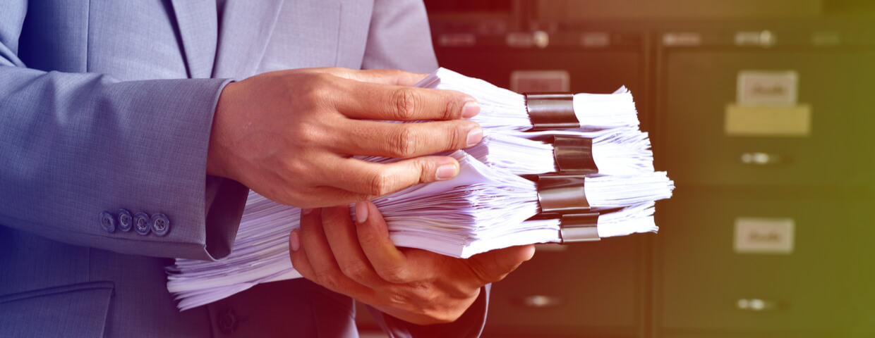 Man holding stack of documents
