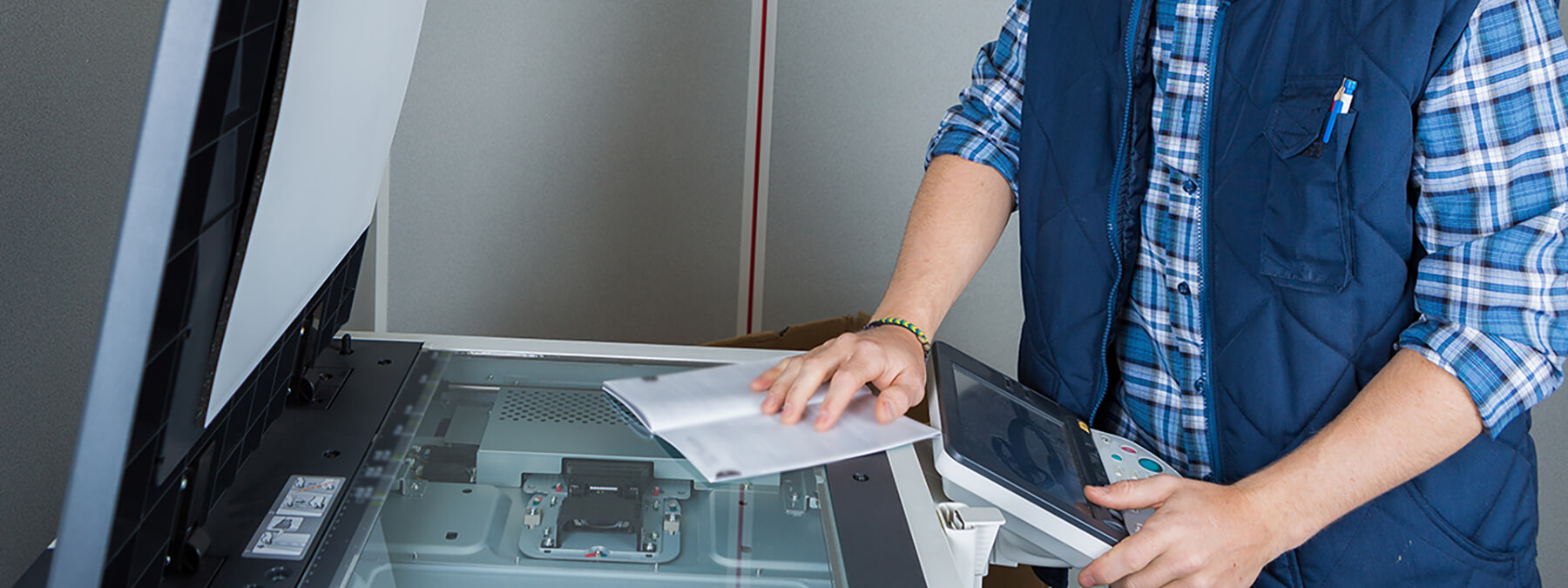 Certified technician troubleshooting a printer