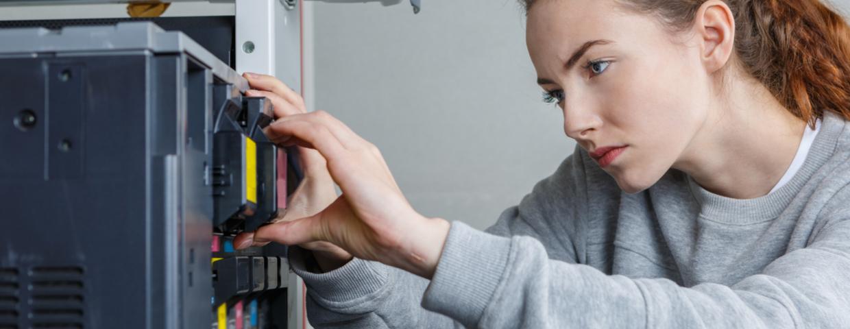 lady repairing printer