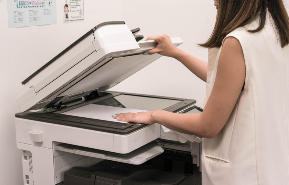 woman scanning document with multifunction printer