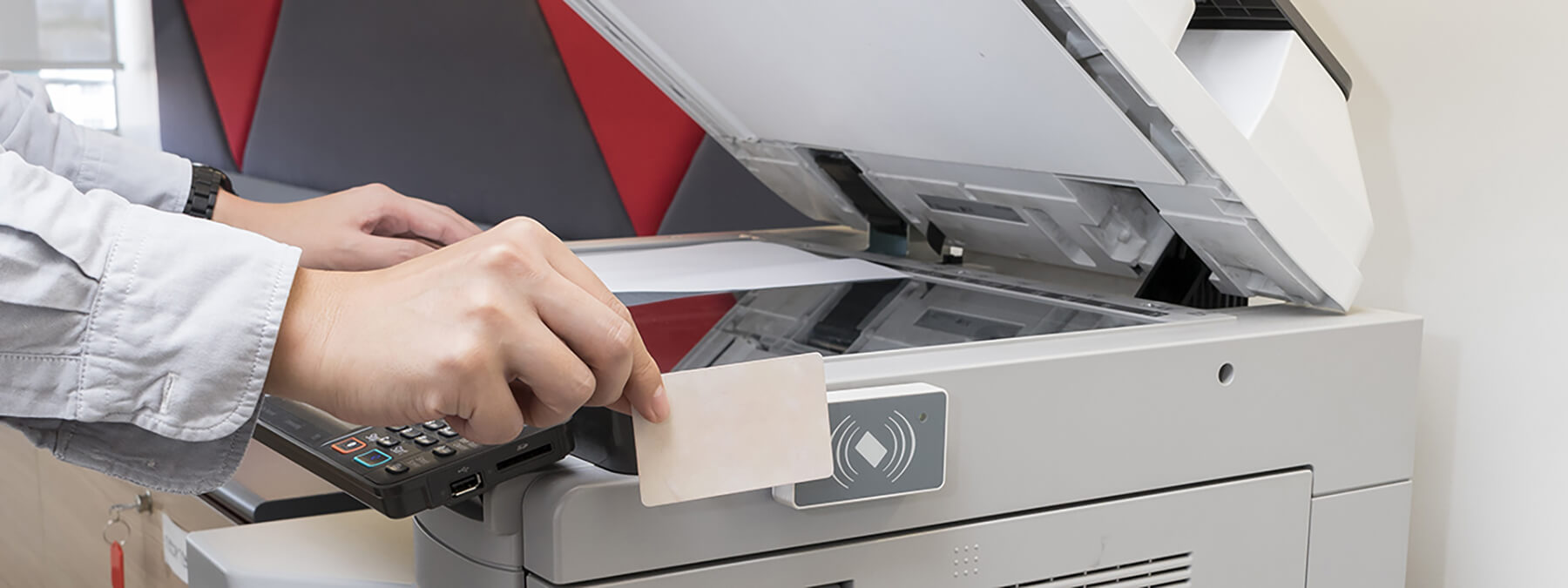 an employee printing securely using their key card