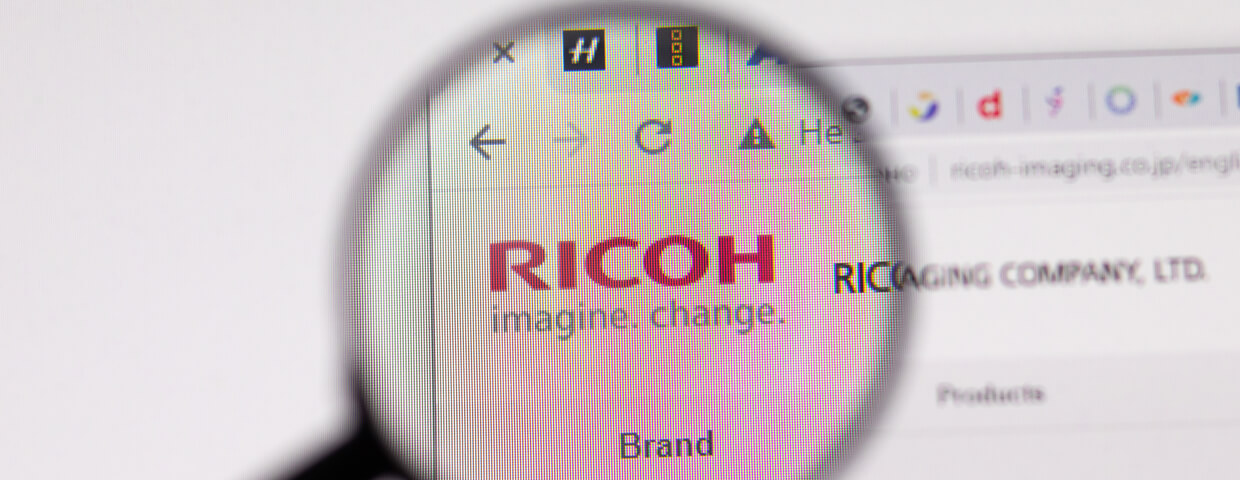 Magnifying glass hovering over Ricoh wesbite
